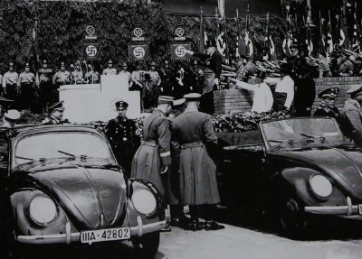 Hitler at the dedication of a VW plant.